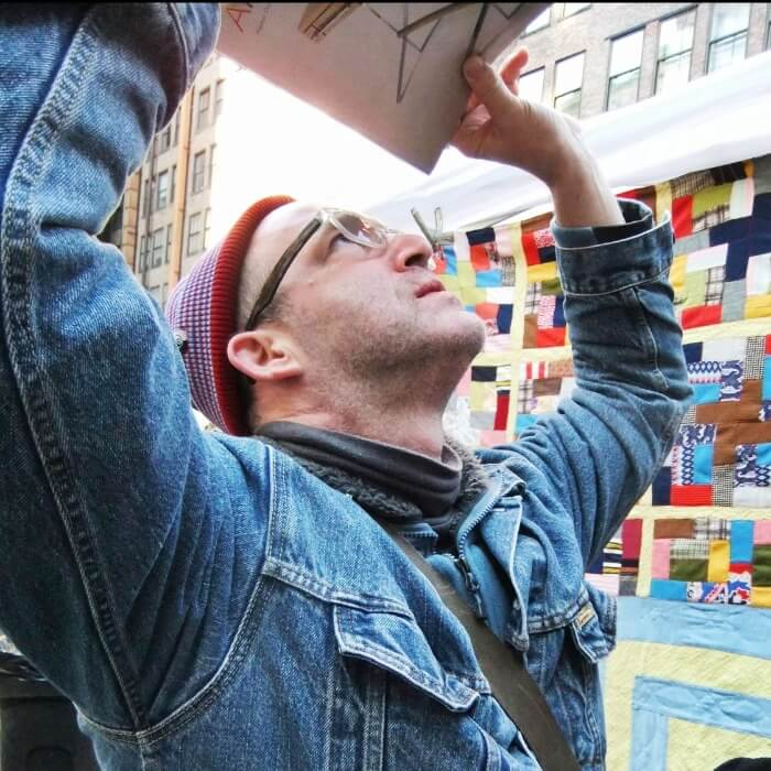 Josh Lowenfels examining art
