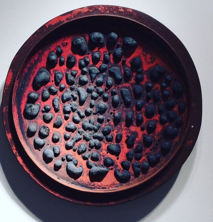 Red Tar Can Lid with black tar blotches