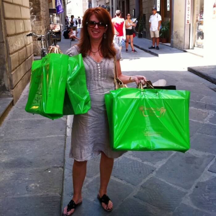 The Curious Cowgirl with shopping bags in Florence