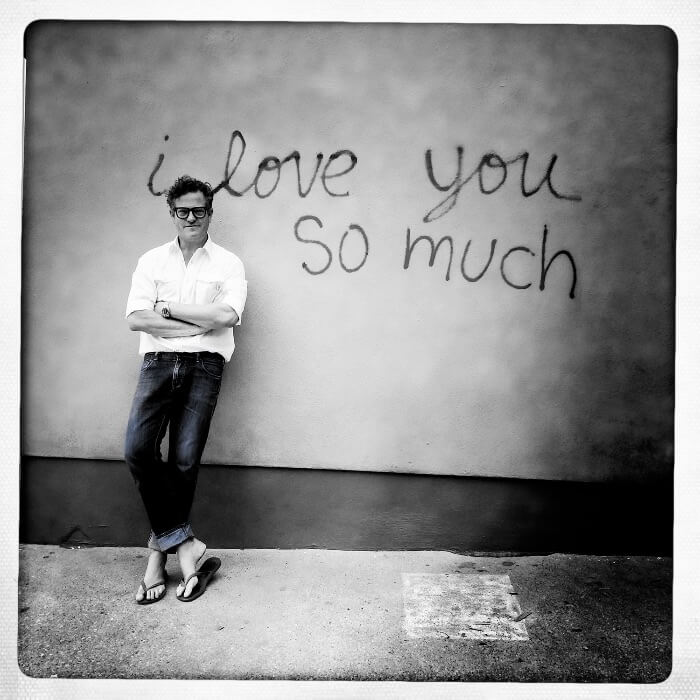 Steve Wrubel in front of  I Love You So Much Graffiti Wall in Austin