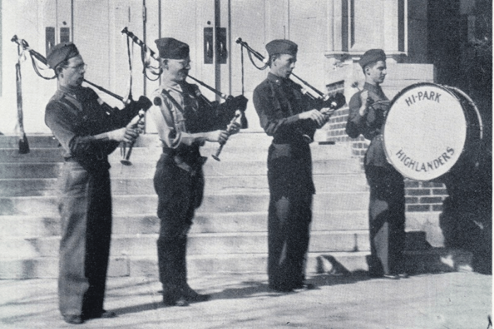 Black and white photo of bagpipers