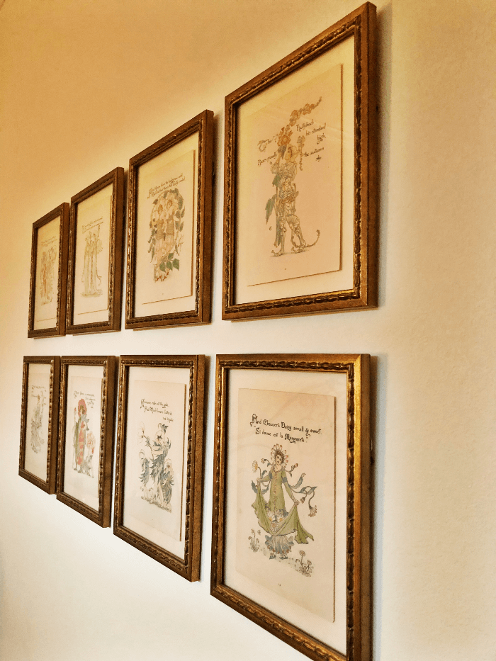 Antique Prints framed and hanging on a wall
