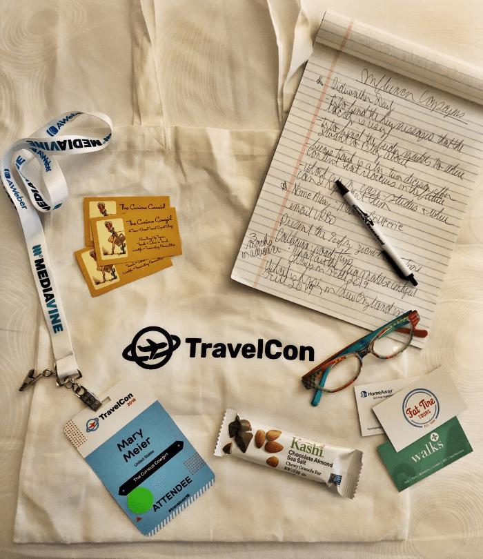 TravelCon Travel Blogger Conference Flay Lay of Curious Cowgirl business cards and Kashi Bar