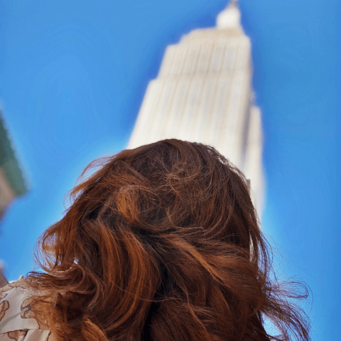 I Resolve The Curious Cowgirl in front of the Empire State Building