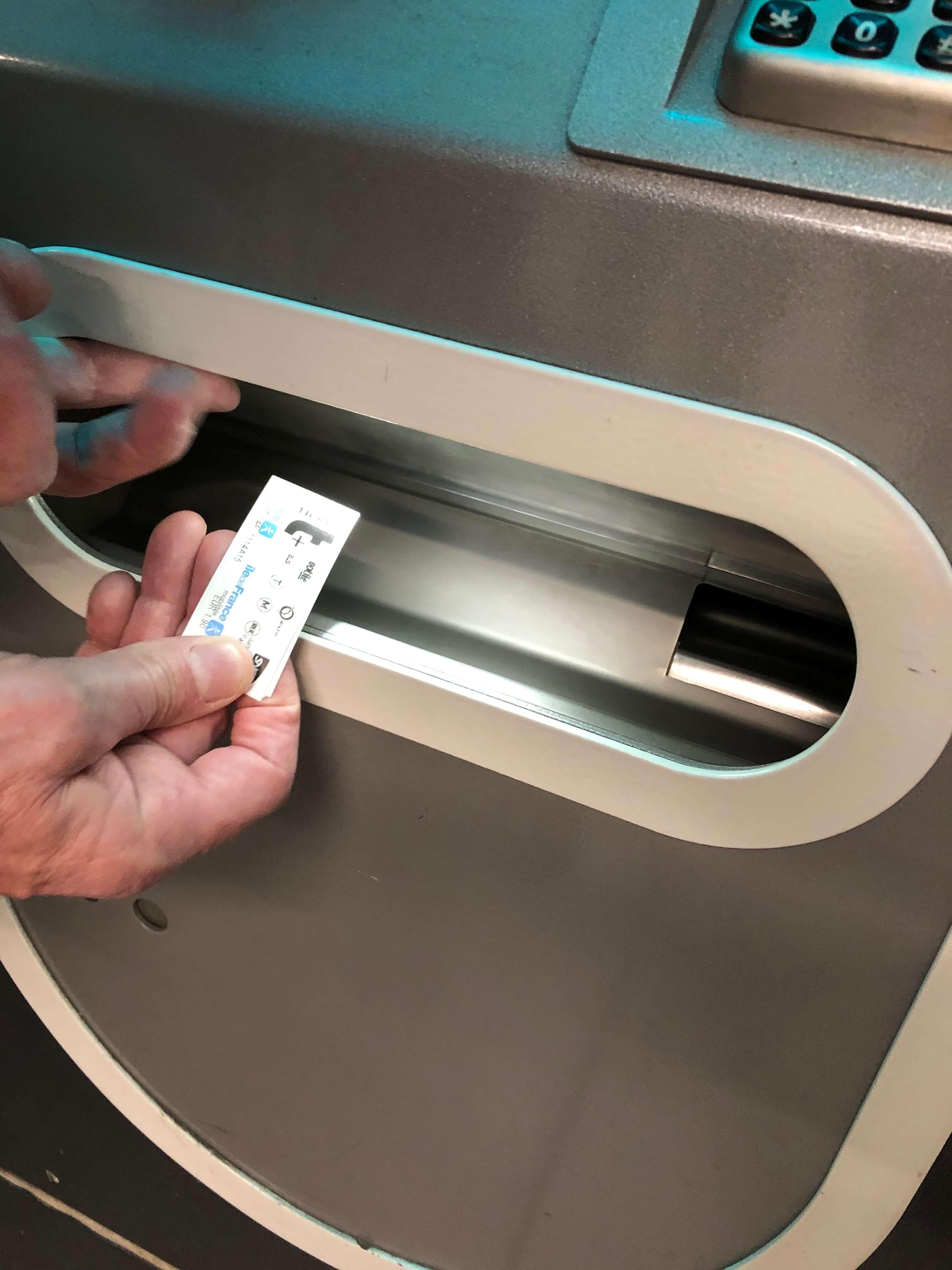 Paris Metro Ticket Machine ticket collection tray