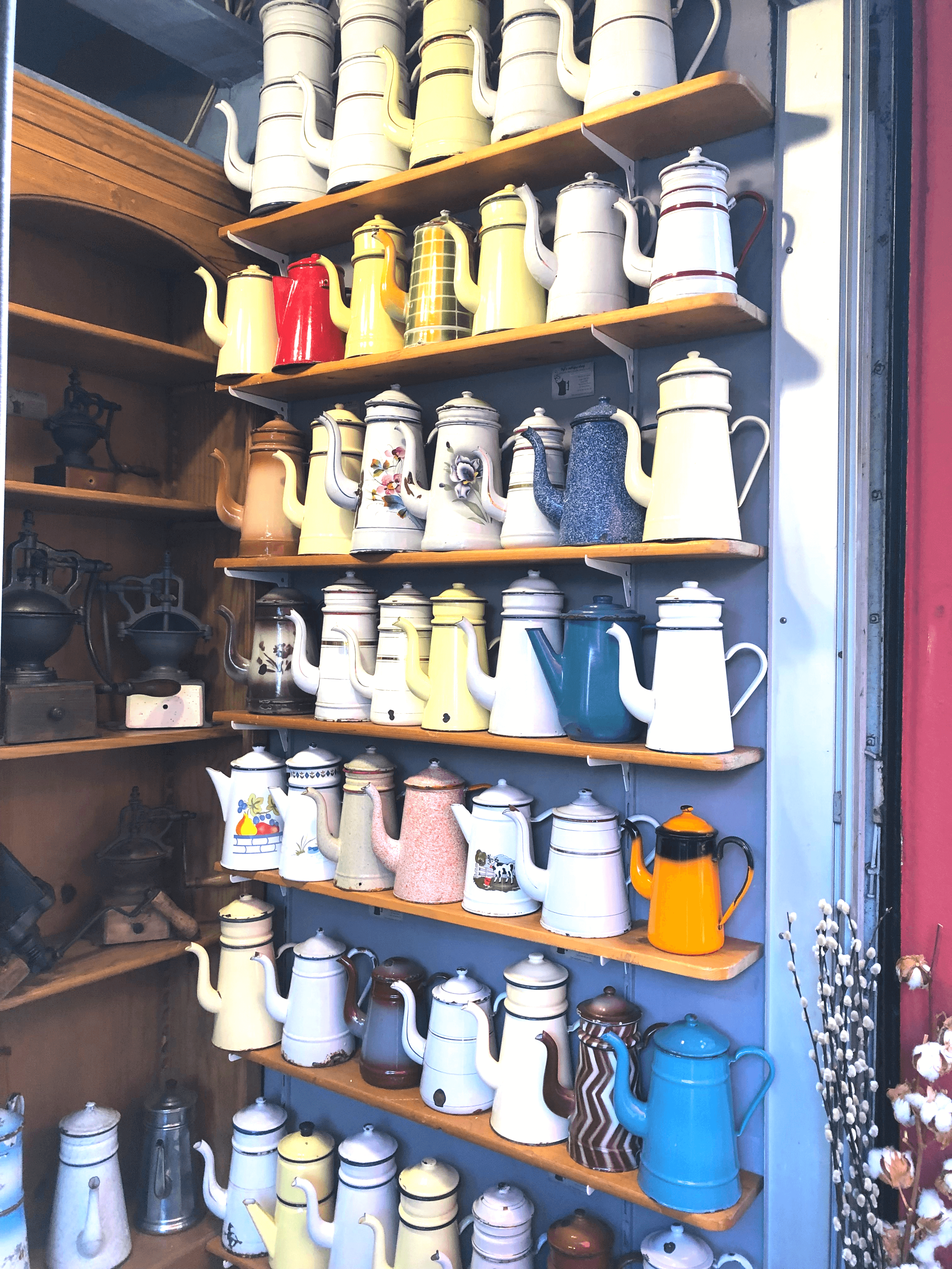 A display of over 30 Vintage French Coffee pots at the Paris Flea Market