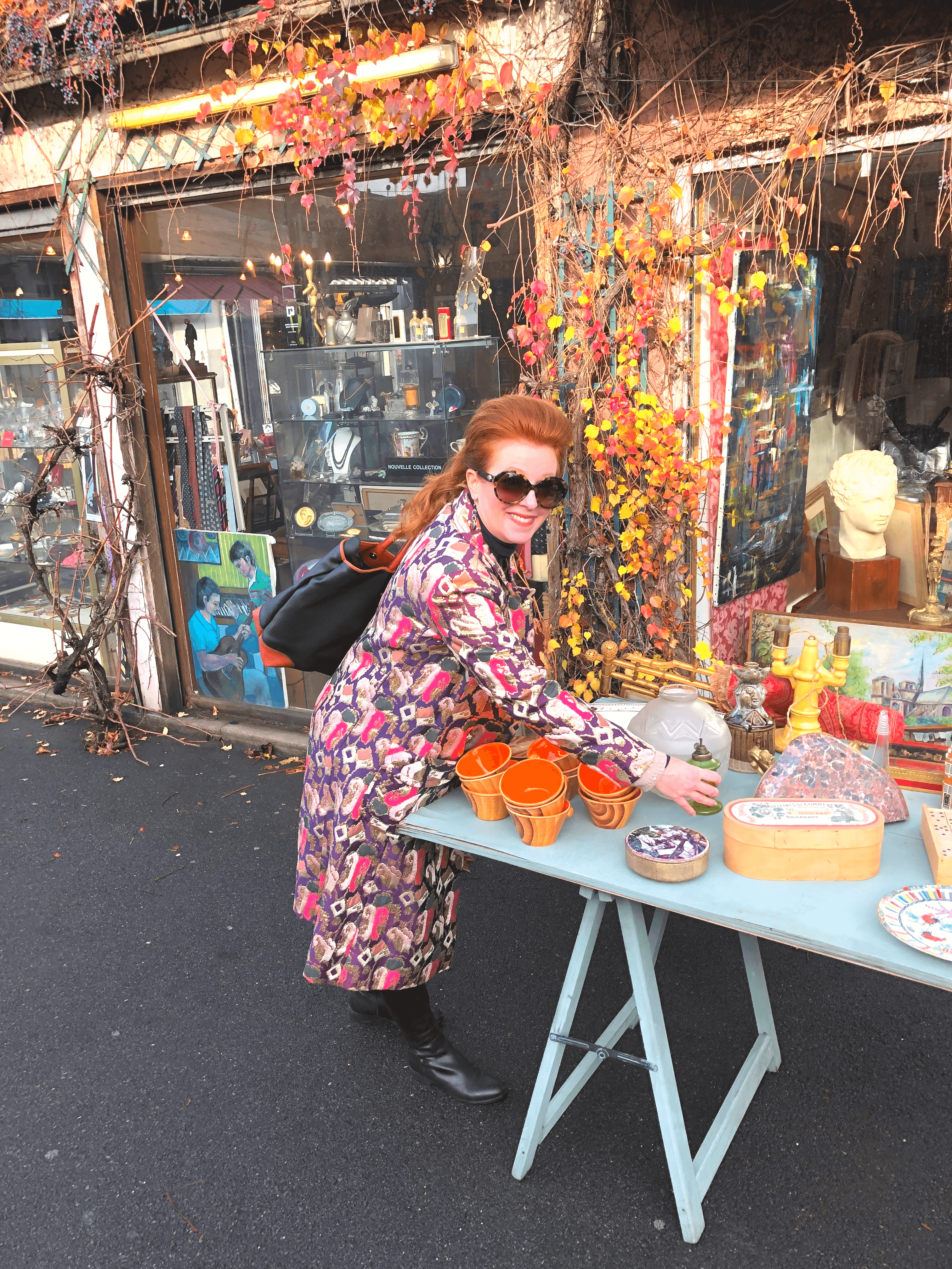 The Curious Cowgirl shopping for vintage orange cups at the Paris Flea Market
