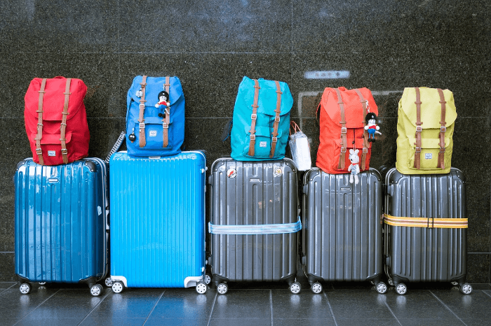 Row of Suitcases and Backpacks