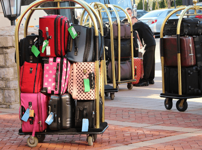 Suitcases stacked on a luggage cart