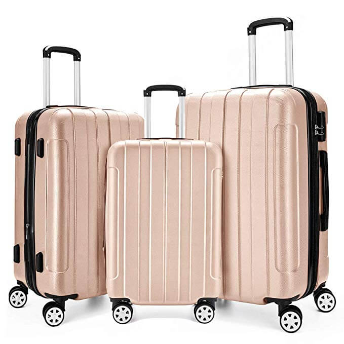 Three pink wheeler suitcases