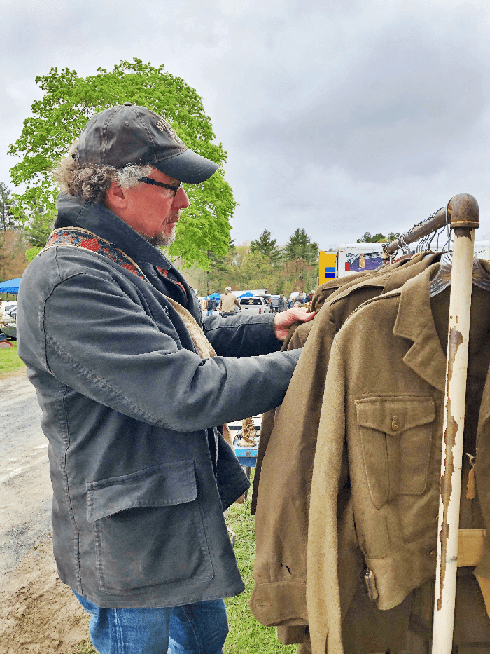Will Evans shopping vintage denim at Brimfield Flea Market