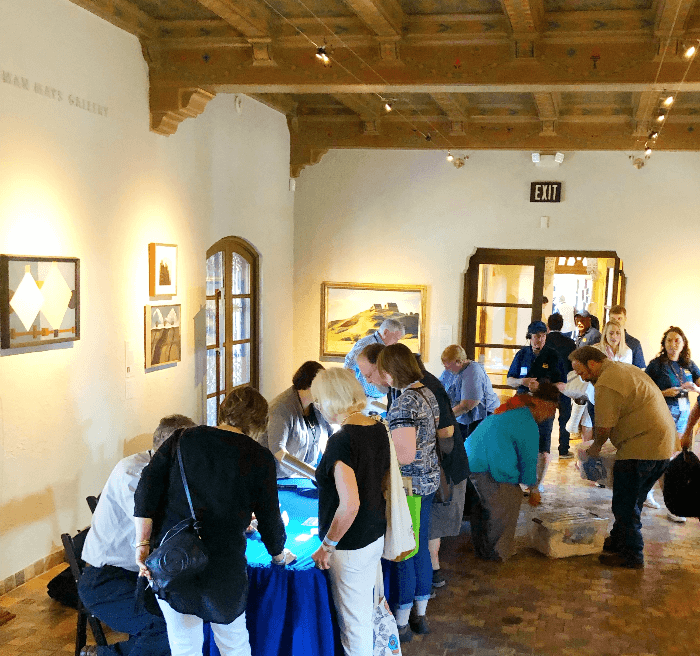 Guests hoping to learn about valuable antiques at the appraisal tables