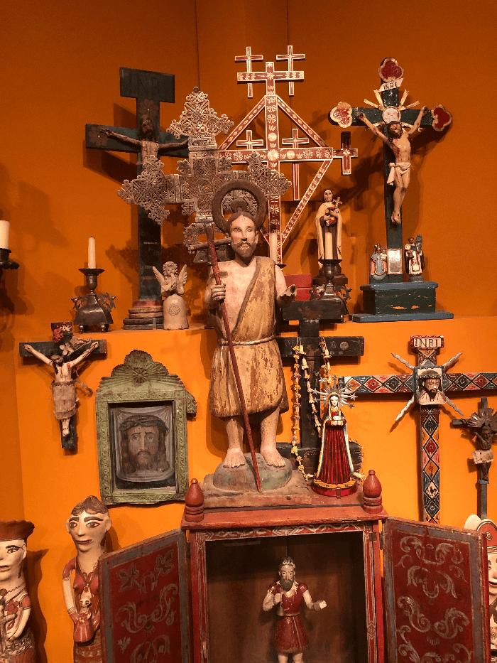 Santa Fe Folk Art Museum Display of crosses and religious icons